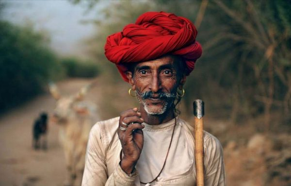 Man with a red turban by Steve McCurry