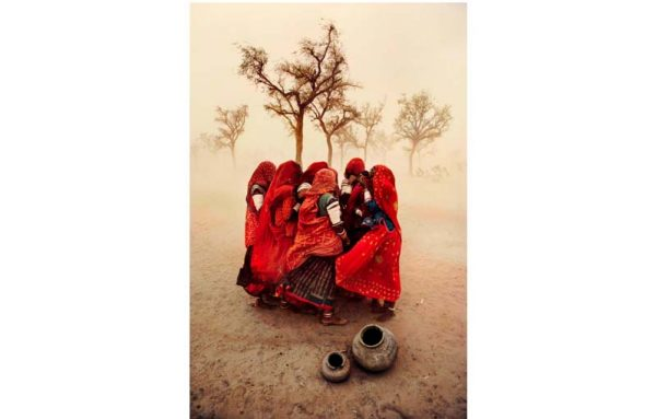 Girls in a desert storm by Steve McCurry